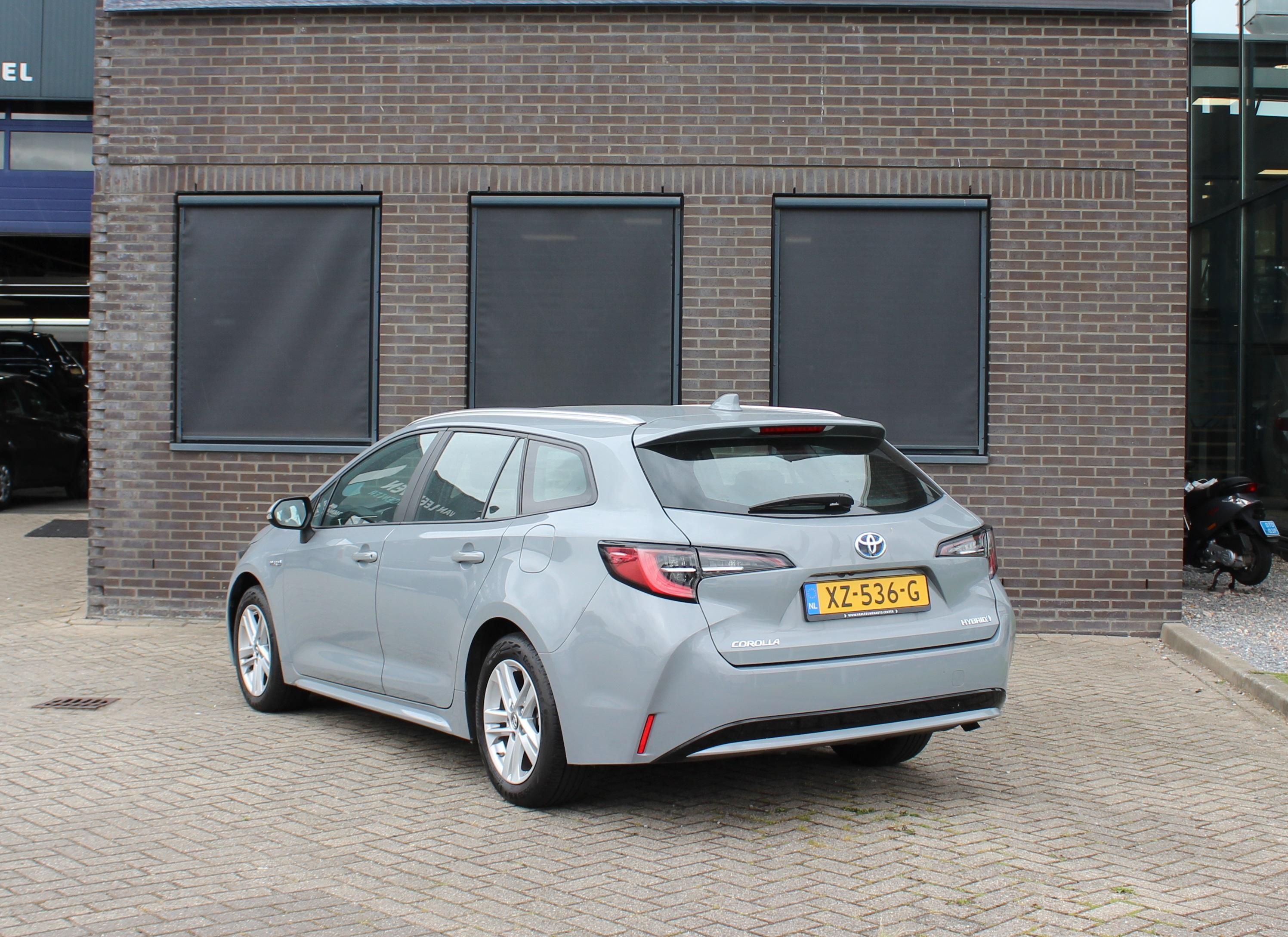 Toyota Corolla TS Hybrid grijs